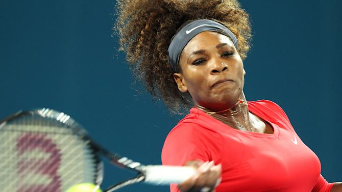 Serena Williams of the U.S. plays a shot in her match against Alize Cornet of France during the Brisbane International tennis tournament in Brisbane, Australia, Tuesday, Jan 1, 2013.  (AP Photo/Tertius Pickard)