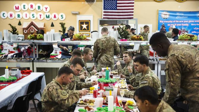 U.S. soldiers from the 3rd Cavalry Regiment eat a Christmas day lunch at forward operating base Gamberi in the Laghman province of Afghanistan