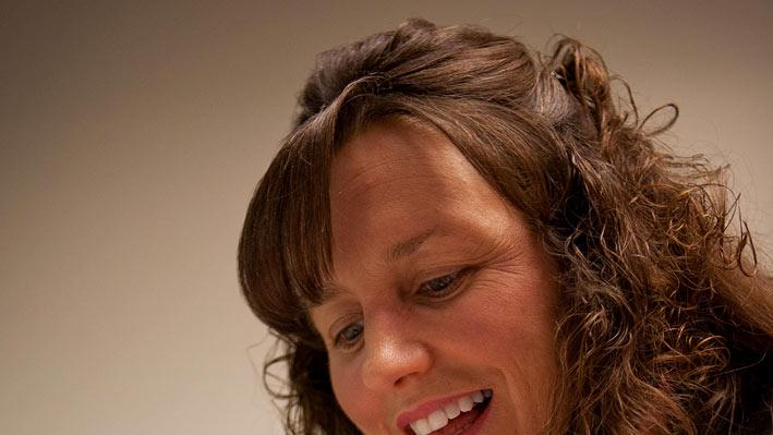 "Michelle Duggar smiling at her brand new daughter, Josie as seen on ""19 Kids & Counting."""