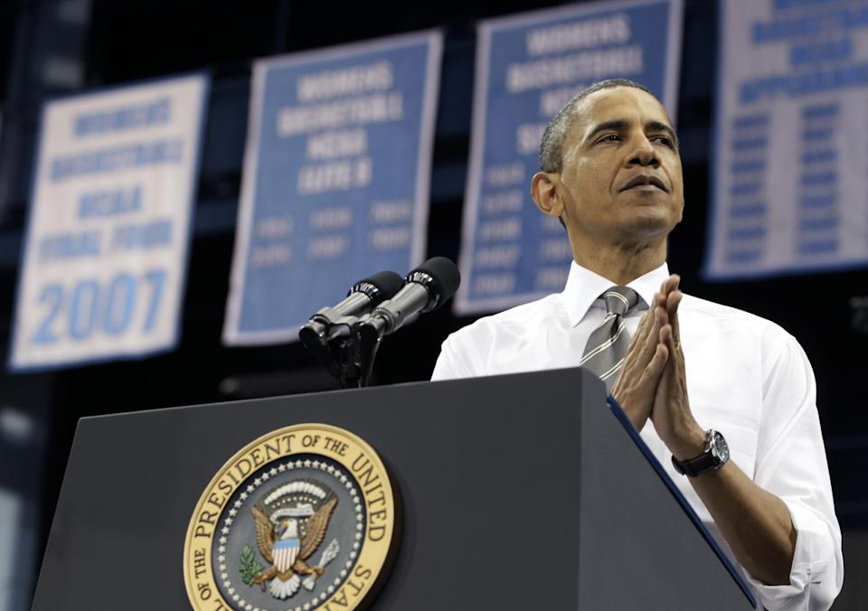 President Barack Obama pauses as he speaks at the University of North Carolina at Chapel Hill, Tuesday, April 24, 2012.  (AP Photo/Carolyn Kaster)