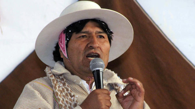 FILE - In this Saturday, July 6, 2013, file photo released by the state news agency, Bolivian Information Agency, Bolivia's President Evo Morales speaks during a meeting with Uru-Chipaya indigenous in Chipaya, Bolivia, where Morales announced NSA leaker Edward Snowden is welcome in Bolivia. Morales made the offer Saturday as he protested that U.S. and European nations had temporarily blocked his flight home from a Moscow summit because they suspected he might have NSA leaker Edward Snowden on board. The flap over the rerouting of his plane prompted days later a special session of the Organization of American States' permanent council. (AP Photo/Bolivian Information Agency, Enzo De Luca, File)