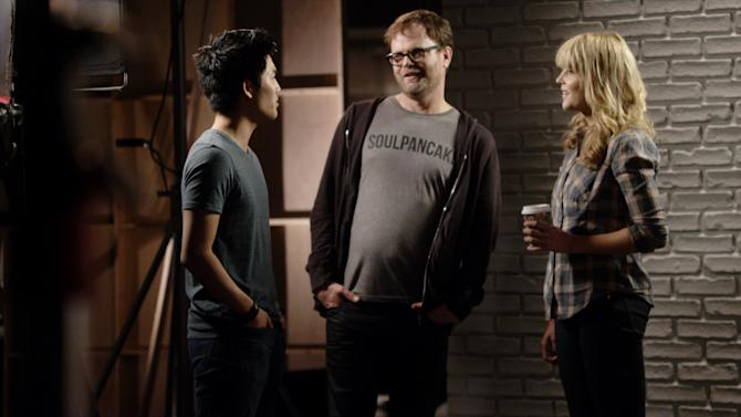 This undated publicity photo provided by Google Inc. shows, from left, Ryan Higa, Rainn Wilson and Grace Helbig shooting a video for YouTube's planned Comedy Week. From May 19-25, 2013, YouTube will host a themed week of comedy programming, featuring live-streams, videos and stand-up routines from comedy stars like Sarah Silverman and Jimmy Kimmel, as well as the less famous comedians of YouTube. (AP Photo/Google Inc., John Lindley)