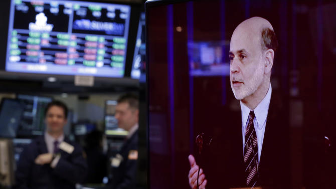 Fed says it will stick with aggressive stimulus