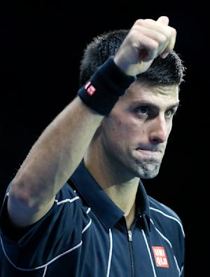 Djokovic downs Federer in 3 sets at ATP Finals