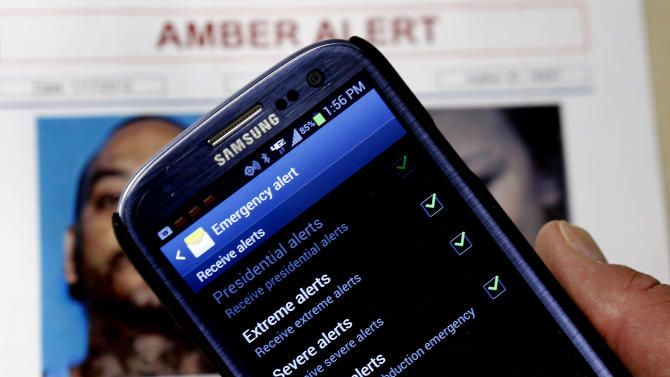 In this Thursday,  Jan. 31, 2013 photo, an Amber Alert app is seen on the cell phone of Capt. Greg Gerrero of the California Highway Patrol in Sacramento, Calif. A new national Amber Alert system will automatically send alerts to millions of cell phones when an alert is issued in their area. The alerts are automatically active on most new phones and users will have to opt out if they do not wish to receive them. (AP Photo/Rich Pedroncelli)