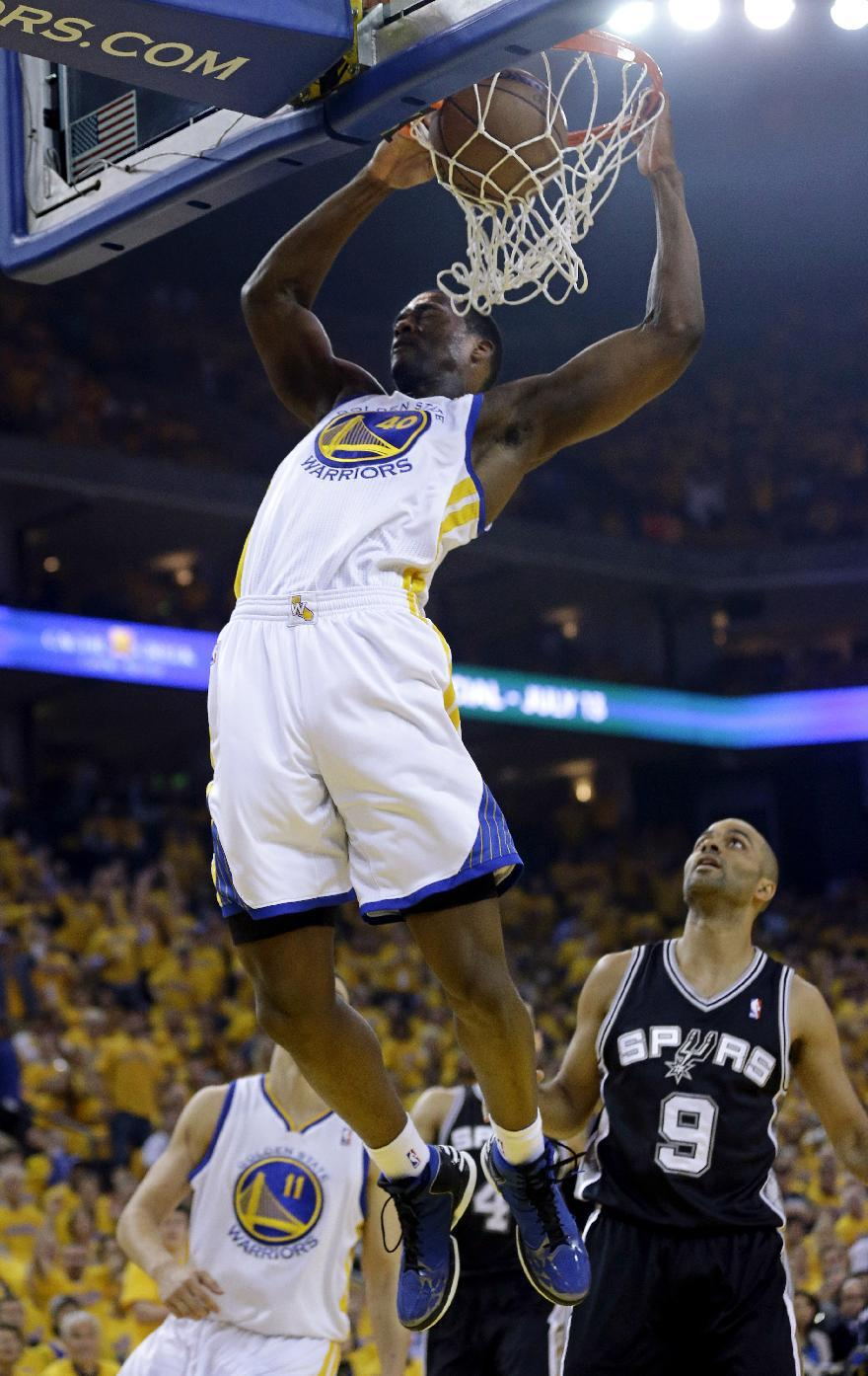 Golden State Warriors forward Harrison Barnes (40) dunks against the San Antonio Spurs in the first quarter of Game 6 of a Western Conference semifinal NBA basketball playoff series in Oakland, Calif., Thursday, May 16, 2013. (AP Photo/Marcio Jose Sanchez)