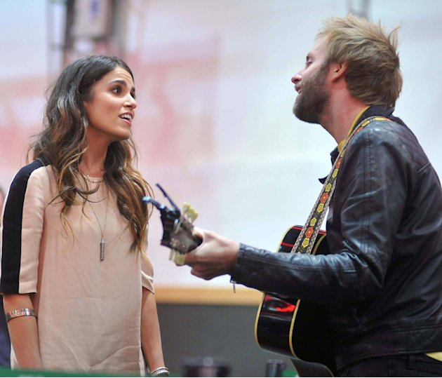 Nikki Reed and Paul McDonald perform a song 'Twilight' stars Kellan Lutz and Nikki Reed attend a signing session at The Dublin Convention Centre to promote the Twilight Saga: Breaking Dawn - Part 2 Du