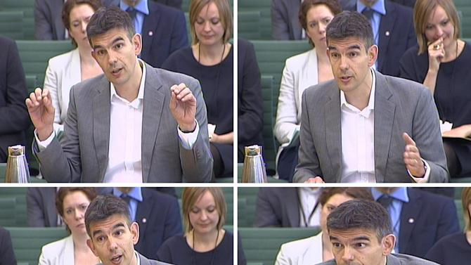 FILE - In these images taken from TV, Google executive Matt Brittin gives evidence to a parliamentary Public Accounts Committee on tax avoidance, in the Boothroyd Room, London in this May 16, 2013 file photo. Brittin defended his company's complicated structure before Britain's Parliament, denying charges that it was misleading authorities to dodge paying tax. Committee chair, Margaret Hodge accused search giant Google of dodging its taxes on Thursday, June 13, 2013 issuing a scathing report that accuses the U.S. Internet company of taking on highly contrived arrangements serving no purpose other than to avoid paying its fair share (AP Photo/PA, File) UNITED KINGDOM OUT