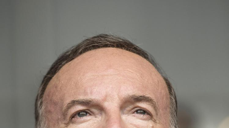 French employer's body MEDEF union leader Pierre Gattaz listens to French Prime Minister's speech during the MEDEF summer forum on the campus of the HEC School of Management in Jouy-en-Josas, near Paris