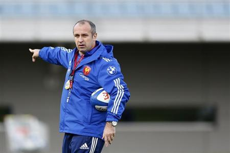 France's rugby team coach Saint-Andre leads a training session at the Rugby Union National Centre in Marcoussis