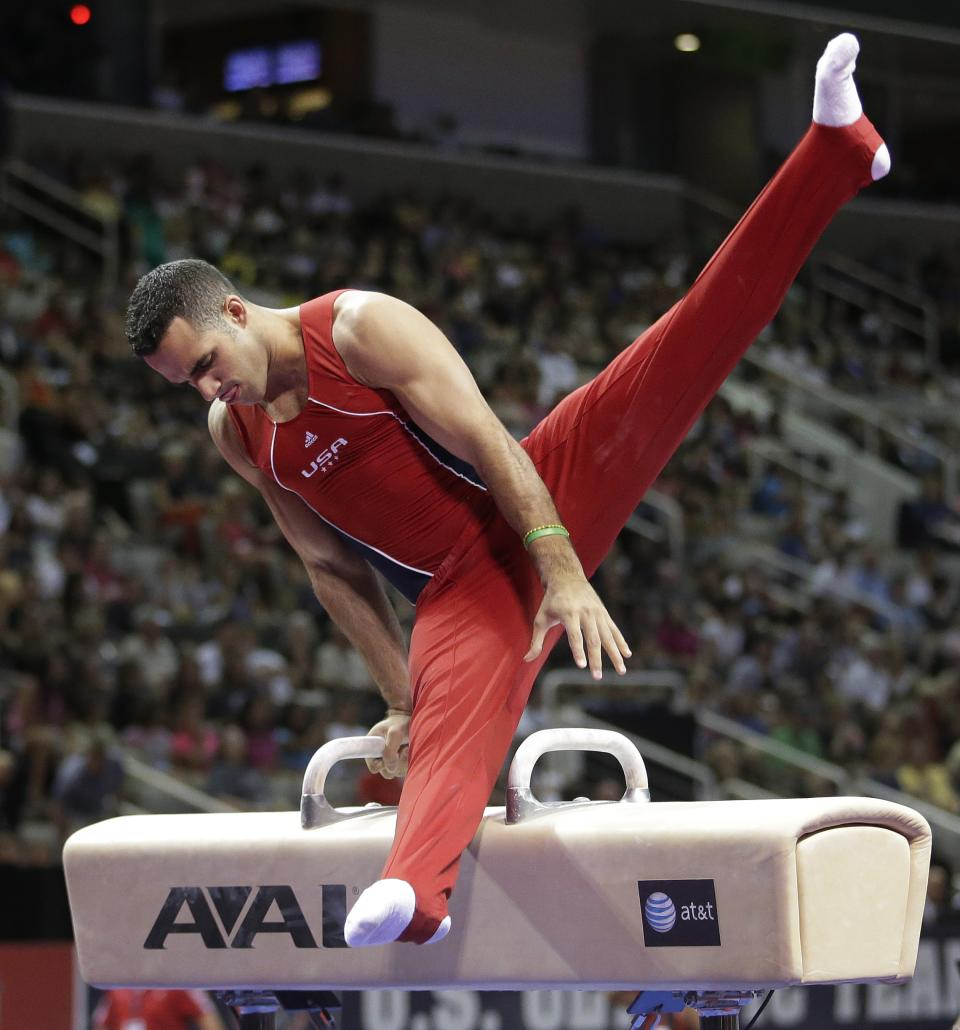 Danell Leyva competes on the pommel horse during the final round of the men's Olympic gymnastics trials, Saturday, June 30, 2012, in San Jose, Calif. (AP Photo/Jae C. Hong)