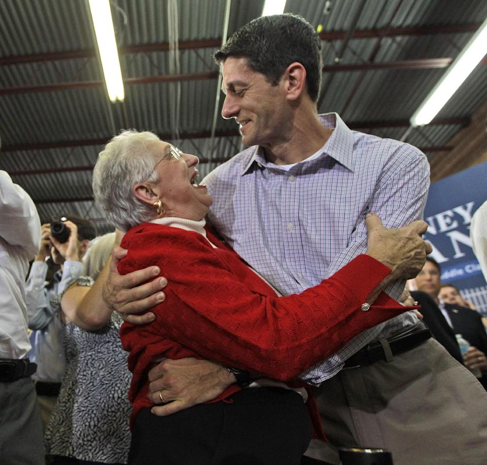 An enthusiastic supporter hugs Republican vice presidential candidate, Rep. Paul Ryan, R-Wis., at a campaign event Sunday, Aug. 12, 2012, in High Point, N.C.  (AP Photo/Mary Altaffer)
