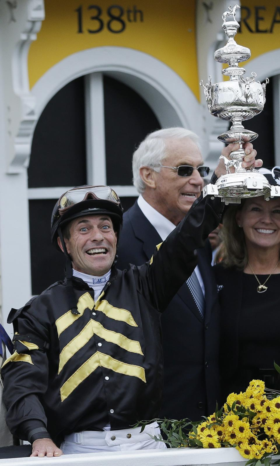 Jockey Gary Stevens holds up a trophy in the winner's circle after riding Oxbow to win the 138th Preakness Stakes horse race at Pimlico Race Course, Saturday, May 18, 2013, in Baltimore. (AP Photo/Matt Slocum)