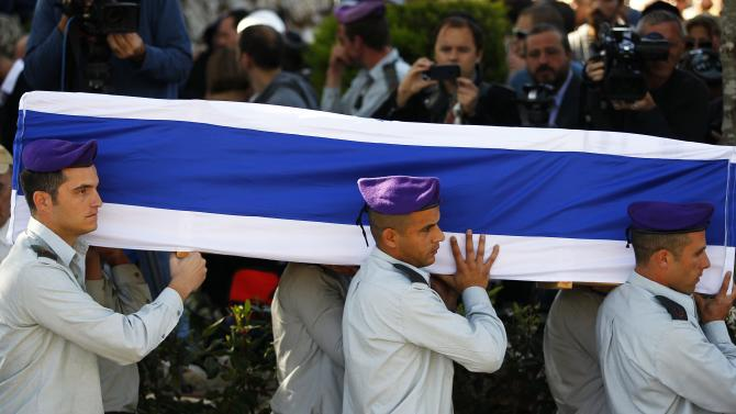 Israeli soldiers carry the flag-draped coffin in Jerusalem