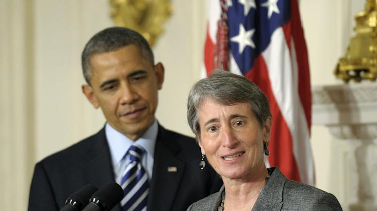 President Barack Obama listens as his Interior Secretary nominee, REI Chief Executive Officer Sally Jewell speaks in the State Dining Room of the White House in Washington, Wednesday, Feb. 6, 2013. (AP Photo/Susan Walsh)