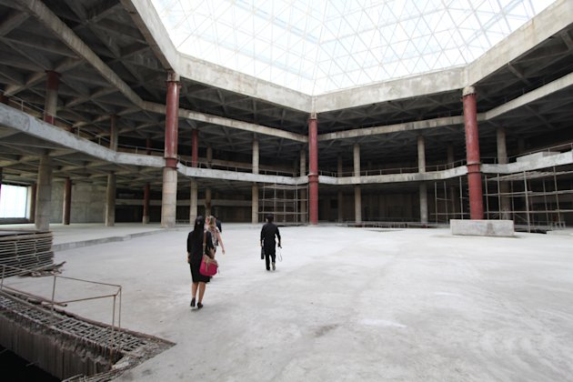In this Sept. 23, 2012 photo released by Koryo Group, visitors tour the top floor of the 105-story Ryugyong Hotel in Pyongyang, North Korea. After years of standing unfinished, construction on the ext