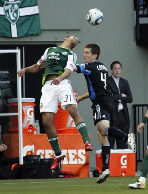 Portland Timbers forward Spencer Thompson, left, heads the ball over San Jose Earthquakes midfielder Sam Cronin during the first half of their MLS soccer game in Portland, Ore., Tuesday, May, 3, 2011.(AP Photo/Don Ryan)