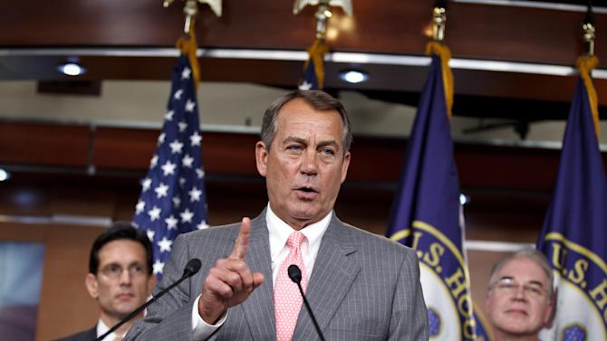 FILE - In this June 28, 2012 file photo, House Speaker John Boehner of Ohio, flanked by House Majority Leader Eric Cantor of Va., left, and Rep. Tom Price, R-Ga., speaks during a news conference on Capitol Hill in Washington.  It looks like a tax, smells like a tax, and the Supreme Court says it must be a tax. But politicians in both parties are squirming over how to define the Thing in President Barack Obama's health care law that requires people to pay up if they don't get health insurance. The problem for Obama is that, if the Thing is indeed a tax, he is by definition a raiser of taxes on the middle class, which he promised not to be. If that sounds like an opportunity for Republican presidential rival Mitt Romney, well, it's not that simple. (AP Photo/J. Scott Applewhite, File)