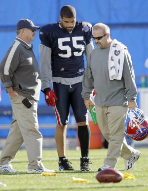 Buffalo Bills' Shawne Merriman (55) walks off the field with trainers during NFL football practice in Orchard Park, N.Y., Wednesday, Nov. 10, 2010.  Merriman  limped off the field with a lower right leg injury shortly after opening his first practice with his new team. (AP Photo/David Duprey)