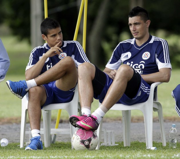 Paraguay's national soccer team players Oscar Cardozo and Lorenzo Melgarejo attend a training session in Ypane