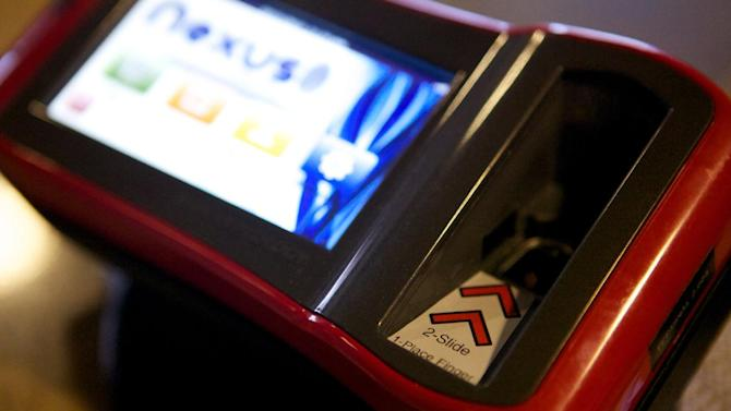 About 50 students and four faculty members at the South Dakota School of Mines and Technology use pay pads such as this one, shown in a Feb. 15, 2013, photograph, in place of cash or credit cards to pay for items. The pilot program using Biocryptology -- or one's fingerprint and hemoglobin -- to identify buyers. (AP Photo, Amber Hunt)