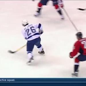 Martin St. Louis scores past a screen on PP