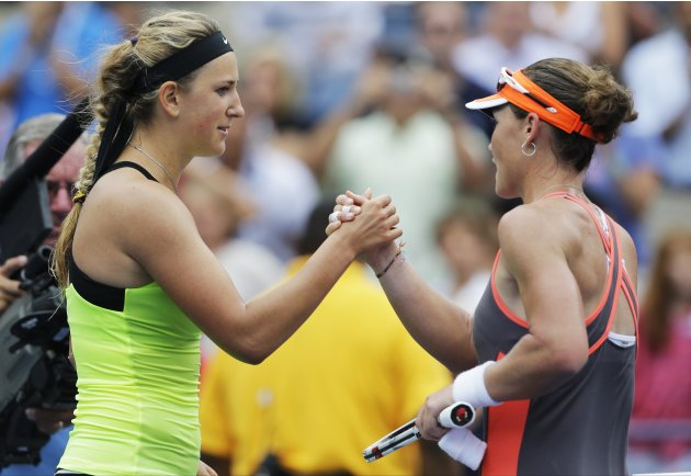 Victoria Azarenka, of Belarus, left, shakes hands with Samantha Stosur, of Australia, after winning their quarterfinals match of the 2012 US Open tennis tournament,  Tuesday, Sept. 4, 2012, in New Yor