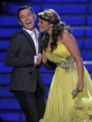 """Finalists Scotty McCreery, left, and Lauren Alaina are seen onstage before the winner is announced at the """"American Idol"""" finale on Wednesday, May 25, 2011, in Los Angeles. (AP Photo/Chris Pizzello)"""