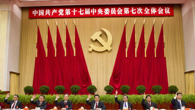In this photo released by China's Xinhua News Agency, Chinese senior leaders Hu Jintao, center, Wu Bangguo, third right, Wen Jiabao, third left, Jia Qinglin, second right, Li Changchun, second left, Xi Jinping, right, Li Keqiang, left, attend the Seventh Plenary Session of the 17th Central Committee of the Communist Party of China (CPC) in Beijing, China, on Sunday, Nov. 4, 2012. The session was held from Nov. 1 to Nov. 4 in Beijing and presided over by the Political Bureau of the CPC Central Committee. (AP Photo/Xinhua, Li Xueren) NO SALES