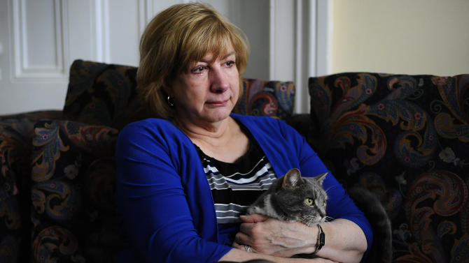In this Tuesday, Feb. 5, 2013 photo, Teresa Rousseau holds her late daughter Lauren Rousseau's cat Laila during an interview with the Associated Press at her home in Danbury, Conn. Lauren Rousseau, 30, a teacher, was one of 26 people killed in the Dec. 14, 2012 massacre at Sandy Hook Elementary School in Newtown, Conn. She will be one of six educators from the school honored posthumously with the 2012 Presidential Citizens Medal, presented at a White House ceremony on Feb. 15. (AP Photo/Jessica Hill)