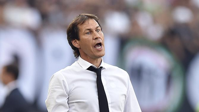 AS Roma's coach Garcia reacts during the match against Juventus in their Serie A soccer match at Olympic stadium in Rome