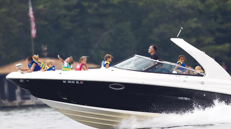 In this July 14, 2012 file photo, Mitt Romney takes his family for a boat ride on Lake Winnipesaukee in Wolfeboro, N.H. (AP Photo/Evan Vucci, File)