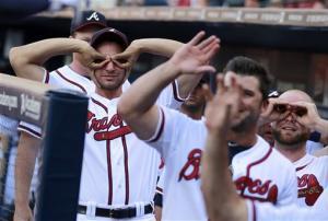 Freeman's HR helps Braves beat Cards, 10-7