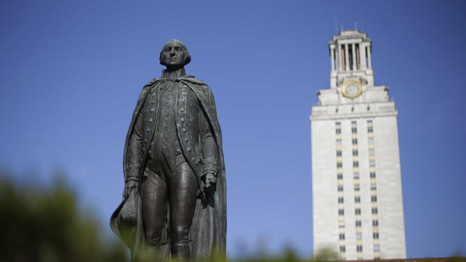 In this Thursday, Nov. 29, 2012 photo, a statue of George Washington stands near the University of Texas Tower at the center of campus, in Austin, Texas. If colleges were automobiles, the University of Texas at Austin would be a Cadillac: a famous brand, a powerful engine of research and teaching, a pleasingly sleek appearance. Even the price is comparable to the luxury car's basic model: In-state tuition runs about $40,000 for a four-year degree. (AP Photo/Eric Gay)