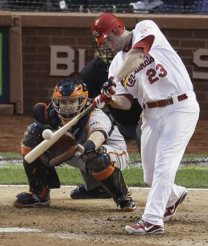 St. Louis Cardinals' David Freese (23) hits a double during the seventh inning of Game 3 of baseball's National League championship series against the San Francisco Giants, Wednesday, Oct. 17, 2012, in St. Louis. (AP Photo/Mark Humphrey)