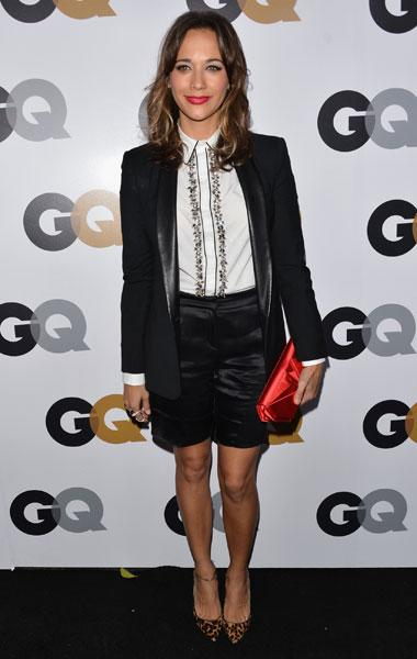 "Rashida Jones: The ""Parks and Recreation"" actress wears a killer menswear outfit with a long tuxedo blazer, satin shorts and a preppy blouse. Topped with a red clutch and leopard-print shoes, Jones still looks feminine and beautiful. (Photo by Alberto E. Rodriguez/Getty Images)"