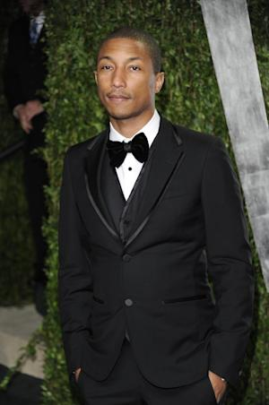 "FILE - Pharrell arrives at the Vanity Fair Oscar party in this Sunday, Feb. 26, 2012 file photo taken in West Hollywood, Calif. Pharrell is engaged in a battle with Marvin Gaye's estate over Robin Thicke's megahit ""Blurred Lines."" Speaking to The Associated Press on Thursday night Sept. 12, 2013, Pharrell said the two songs, ""Blurred Lines,"" and ""Got to Give it Up"" are completely different and not even in the same key. But he added that he is a huge fan of Gaye and that he's ""the king of all kings."" (AP Photo/Evan Agostini, File)"