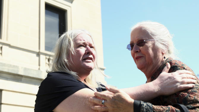 Janet, left, and Jeanne Tessier embrace outside the DeKalb County Courthouse in Sycamore, Ill. on Friday, Sept. 14, 2012, following the guilty verdict of their half-brother, Jack McCullough, for the 1957 disappearance and murder of 7-year-old Maria Ridulph, of Sycamore. The 72-year-old McCullough was convicted Friday in one of the oldest unsolved crimes to eventually get to court in the U.S. (AP Photo/Daily Chronicle, Kyle Bursaw)  MANDATORY CREDIT, CHICAGO LOCALS OUT, ROCKFORD OUT