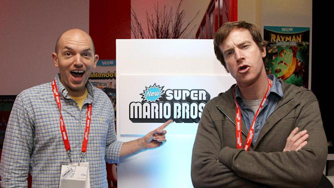 Actors Paul Scheer, left, and Rob Huebel warm up and check out Wii U at the Nintendo Lounge during a break from the Sundance Film Festival on Sunday, Jan. 20, 2013 in Park City, UT. (Photo by Donald Traill/Invision for Nintendo/AP Images)
