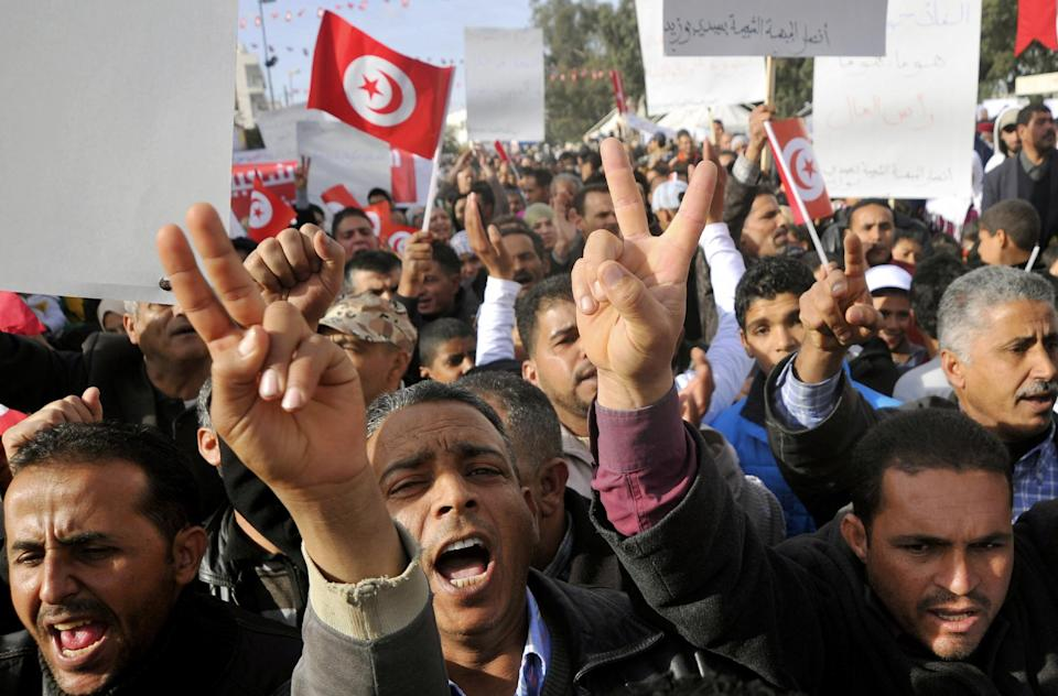 Demonstrators protest against the visit of Tunisian President Moncef Marzouki, Monday, Dec.17, 2012, in Sidi Bouzid, south Tunisia, the birthplace of the country's recent revolution. Marzouki arrived to mark the revolution's second anniversary. (AP Photo/Hichem Borni)