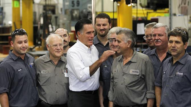 Republican presidential candidate, former Massachusetts Gov. Mitt Romney meets with workers as he campaigns at Acme Industries in Elk Grove Village, Ill.,Tuesday, Aug. 7, 2012. (AP Photo/Charles Dharapak)
