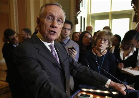 U.S. Senate Majority Leader Harry Reid (D-NV) speaks to the media following a Senate cloture vote on budget bill on Capitol Hill in Washington