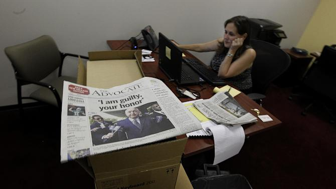 Sara Pagones, bureau chief of the new Baton Rouge Advocate New Orleans bureau talks on the phone with computer boxes in the foreground in their  temporary workspace in New Orleans, Thursday, Sept. 27, 2012.  As The Times-Picayune in New Orleans scales back its print edition to three days a week, the Baton Rouge newspaper is starting its own daily edition to try to fill the void. The move by The Advocate sets up an old-fashioned newspaper competition, even as more and more people get their news online and from cellphones. (AP Photo/Gerald Herbert)