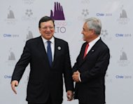 &lt;p&gt;European Commission President Jose Manuel Barroso (L), is welcomed by Chilean President Sebastian Pinera to the opening of the Latin American and Caribbean States-European Union Summit in Santiago, on January 26, 2013. European and Latin American leaders pledged to shun protectionism and boost their strategic partnership to foster free trade.&lt;/p&gt;