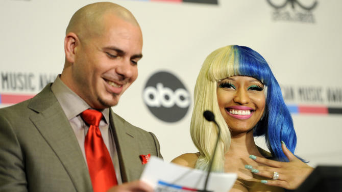 Rapper Pitbull, left, and performer Nicky Minaj announce nominations for the 2011 American Music Awards, Tuesday, Oct. 11, 2011, in Los Angeles. The awards will be held in Los Angeles on Nov. 20. (AP Photo/Chris Pizzello)