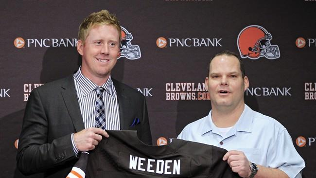 Cleveland Browns first round pick quarterback Brandon Weeden, left, poses with general manager Tom Heckert at the NFL football team's headquarters in Berea, Ohio Friday, April 27, 2012. Weeden was taken with the 22nd overall pick in the 2012 NFL draft. (AP Photo/Mark Duncan)