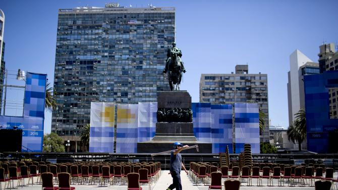 A man works at Independence Square ahead of the Inauguration ceremony in Montevideo, Uruguay Saturday, Feb. 28, 2015. Uruguay's President-elect Tabare Vazquez is to be sworn-in Sunday for a second term. (AP Photo/Natacha Pisarenko)