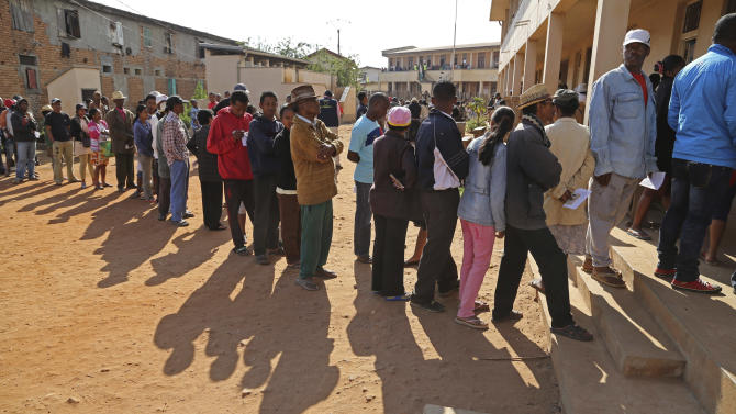 People stand in line to vote at a polling station during elections in Antananarivo, Madagascar, Friday, Oct. 25, 2013. Madagascar holds elections on Friday in an effort to end political tensions that erupted in a 2009 coup and lift the aid-dependent country out of poverty. (AP Photo/Schalk van Zuydam)(AP Photo/Schalk van Zuydam)
