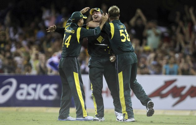 Australia's Peter Forrest celebrates with teammates Ricky Ponting and Brett Lee after taking a catch to dismiss India's Ravindra Jadeja during their one-day international cricket match in Bris