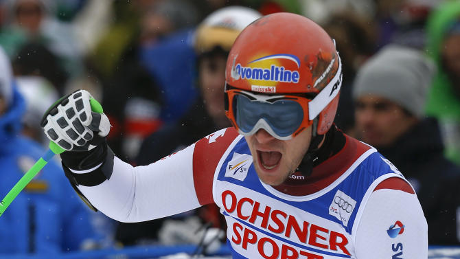 Switzerland's Patrick Kueng reacts after crossing the finish line to take first place in a men's World Cup super-G skiing event, Saturday, Dec. 7, 2013, in Beaver Creek, Colo. (AP Photo/ Julie Jacobson)